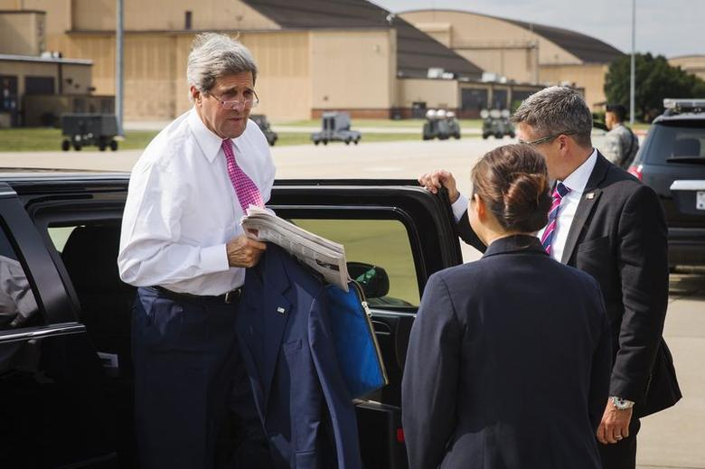 U.S. Secretary of State John Kerry (L) arrives to board a plane to New Delhi at Andrews Air Force Base outside Washington July 29, 2014. REUTERS/Lucas Jackson
