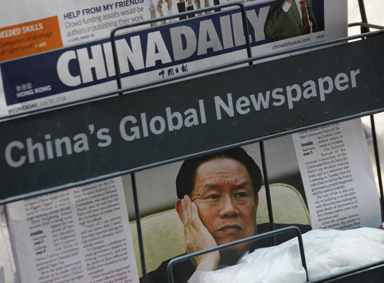 A newspaper with a picture of China's then Politburo Standing Committee Member Zhou Yongkang is seen at a newsstand in Hong Kong July 30, 2014.  REUTERS/Bobby Yip