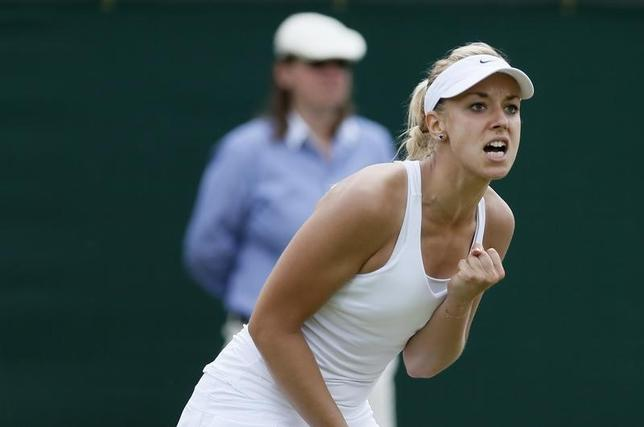 Sabine Lisicki of Germany reacts during her women's singles tennis match against Yaroslava Shvedova of Kazakhstan at the Wimbledon Tennis Championships, in London July 1, 2014.   REUTERS/Stefan Wermuth