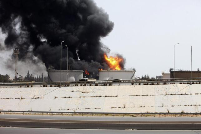 A general view shows fire burning at a fuel depot near the airport road in Tripoli July 29, 2014.  REUTERS/Hani Amara