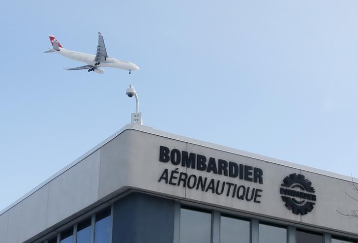 A plane flies over a Bombardier plant in Montreal, January 21, 2014. REUTERS/Christinne Muschi