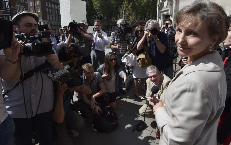 Marina Litvinenko, the wife of former KGB agent Alexander Litvinenko who was murdered in London in 2006, speaks outside the Royal Courts of Justice in London July 31, 2014.  REUTERS/Toby Melville