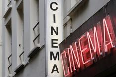 Cinema neon light signs are seen at the entrance of Le Beverley adult cinema in Paris July 30, 2014. REUTERS/Christian Hartmann