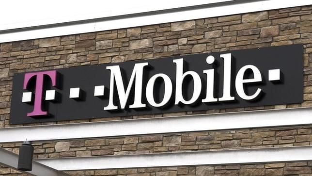 The T-Mobile store sign is seen in Broomfield, Colorado February 25, 2014. . REUTERS/Rick Wilking