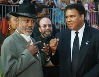 Boxers Joe Frazier (L) and Muhammad Ali pose together as they arrive at the 10th annual ESPY Awards which honor excellence in all sports, July 10, 2002 in Hollywood. REUTERS/Fred Prouser
