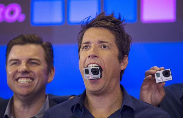 GoPro Inc's founder and CEO Nick Woodman holds a GoPro camera in his mouth at GoPro Inc's IPO at the Nasdaq Market Site in New York City in this file photo taken June 26, 2014.  REUTERS/Mike Segar/Files