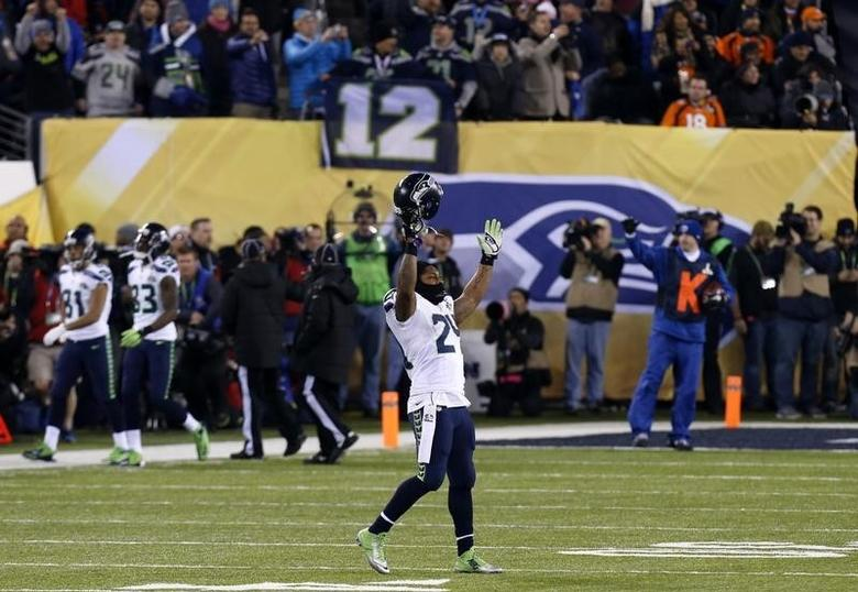Seattle Seahawks Marshawn Lynch celebrates a teammate's touchdown against the Denver Broncos in the third quarter of the NFL Super Bowl XLVIII football game in East Rutherford, New Jersey, February 2, 2014. REUTERS/Brendan McDermid