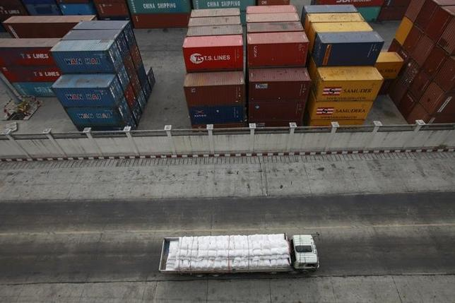 A truck passes near a container yard at a port in Yangon April 18, 2013. REUTERS/Soe Zeya Tun/Files