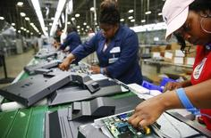 Workers on the assembly line work on installing the motherboard on the reverse side of a 32-inch TV at Element Electronics in Winnsboro, South Carolina May 29, 2014.REUTERS/Chris Keane
