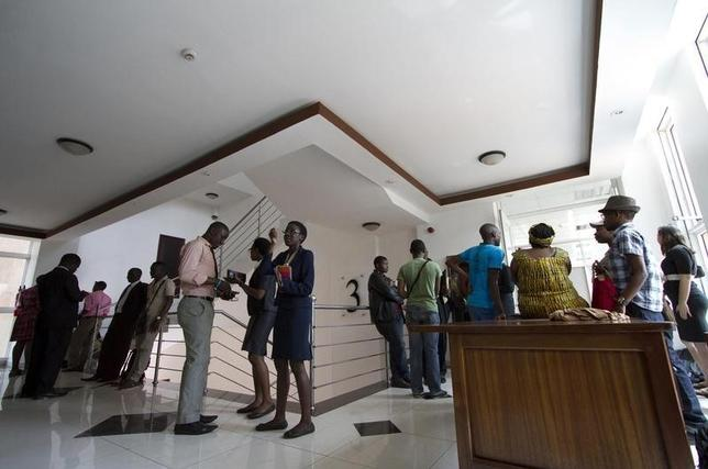 Gay and human rights activists wait outside the courts before filing a constitutional petition against a new anti-homosexuality law, in Uganda's capital Kampala March 11, 2014.  REUTERS/Edward Echwalu