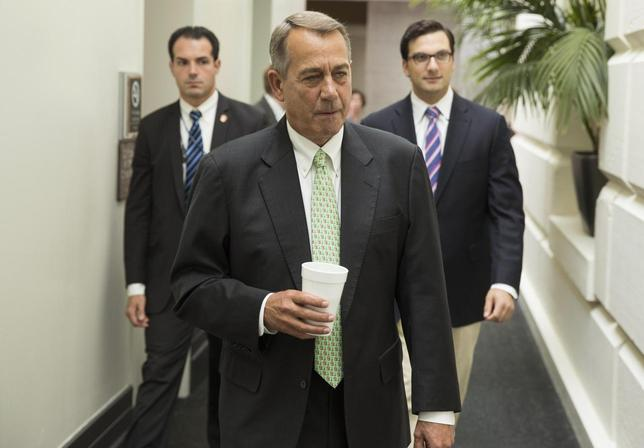 Speaker of the House John Boehner (R-OH) arrives for a Republican caucus meeting at the Capitol in Washington August 1, 2014.  REUTERS/Joshua Roberts