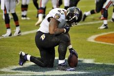 Nov 17, 2013; Chicago, IL, USA; Baltimore Ravens running back Ray Rice (27) celebrates scoring a touchdown against the Chicago Bears during the first quarter at Soldier Field. Mandatory Credit: Rob Grabowski-USA TODAY Sports
