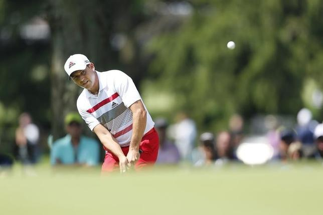 Jul 31, 2014; Akron, OH, USA; Sergio Garcia chips to the tenth green during the first round of the WGC-Bridgestone Invitational golf tournament at Firestone Country Club - South Course. Mandatory Credit: Joe Maiorana-USA TODAY Sports