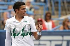 Aug 1, 2014; Washington, DC, USA; Milos Raonic gestures against Steve Johnson (not pictured) on day five of the Citi Open tennis tournament at the Fitzgerald Tennis Center. Raonic won 7-6, 6-2. Mandatory Credit: Geoff Burke-USA TODAY Sports - RTR40Z41