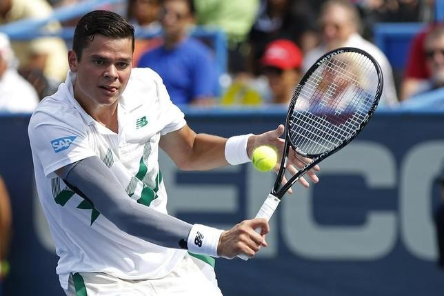 Aug 2, 2014; Washington, DC, USA; Milos Raonic hits a forehand against Donald Young (not pictured) on day six in a men's singles semi-final of the Citi Open tennis tournament at the Fitzgerald Tennis Center. Raonic won 6-4, 7-5. Mandatory Credit: Geoff Burke-USA TODAY Sports - RTR4116Q