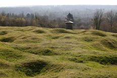 WWI shell craters are seen below the Douaumont cemetery with its Abri 320 (Rear C) a large four shelter French bunker system near Verdun, northeastern France, in this March 30, 2014 file picture. REUTERS/Charles Platiau/Files