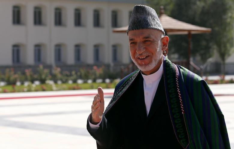 Afghanistan's President Hamid Karzai addresses the media after Eid al-Fitr prayers to mark the end of Ramadan, at the presidential palace in Kabul July 28, 2014. REUTERS/Omar Sobhani