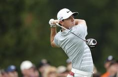 Aug 3, 2014; Akron, OH, USA; Rory McIlroy tees off on the sixth hole during the final round of the WGC-Bridgestone Invitational golf tournament at Firestone Country Club - South Course. Joe Maiorana-USA TODAY Sports