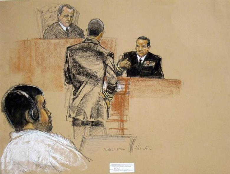 In this sketch approved by the military by court artist Janet Hamlin, and obtained by Reuters on November 9, 2011, Abd Al Rahim Hussayn Muhammad al-Nashiri (L) watches courtroom proceedings. REUTERS/Janet Hamlin/Handout