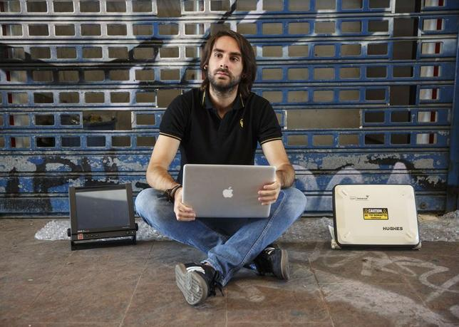 Cybersecurity researcher Ruben Santamarta poses for a photo in Coslada, near Madrid, July 30, 2014.  REUTERS/Andrea Comas