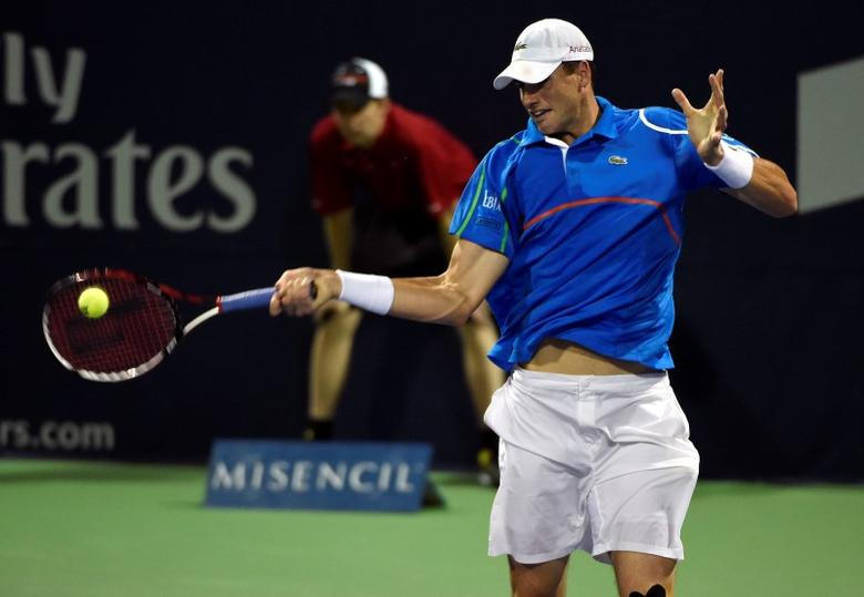 Aug 4, 2014; Toronto, Ontario, Canada;  John Isner (USA) hits a forehand against Ivan Dodig (CRO) in the 1st round of The Rogers Cup at Rexall Centre.. Peter Llewellyn-USA TODAY Sports