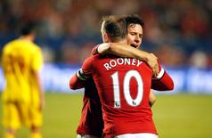 Aug 4, 2014; Miami Gardens, FL, USA; Manchester United midfielder Juan Mata congratulates forward Wayne Rooney (10) after his goal in the second half against Liverpool at Sun Life Stadium. Mandatory Credit: Robert Mayer-USA TODAY Sports