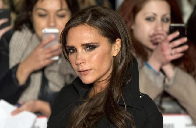 Former Spice Girls singer Victoria Beckham attends the world premier of the film ''The Class of 92'' in London December 1, 2013. REUTERS/Neil Hall