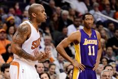 Dec 23, 2013; Phoenix, AZ, USA; Phoenix Suns forward P.J. Tucker (17) reacts to a technical foul called against him in the first half against the Los Angeles Lakers at US Airways Center.  The Suns won 117-90. Jennifer Stewart-USA TODAY Sports