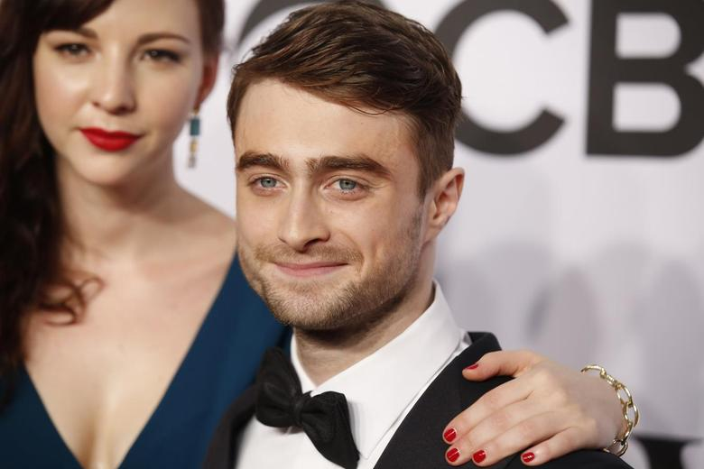 Actor Daniel Radcliffe arrives with girlfriend Erin Darke for the American Theatre Wing's 68th annual Tony Awards at Radio City Music Hall in New York, in this file photo taken June 8, 2014.    REUTERS/Andrew Kelly/Files