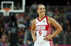 Russia's Becky Hammon smiles toward her bench during the women's preliminary round Group B basketball match against Brazil at the Basketball Arena during the London 2012 Olympic Games in this file photo taken July 30, 2012. REUTERS/Mike Segar/Files