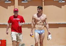 Apr 23, 2014; Mesa, AZ, USA; Michael Phelps arrives with his coach Bob Bowman for his first official practice session for the Arena Grand Prix swim meet at Skyline Aquatic Center. Rob Schumacher-USA TODAY Sports