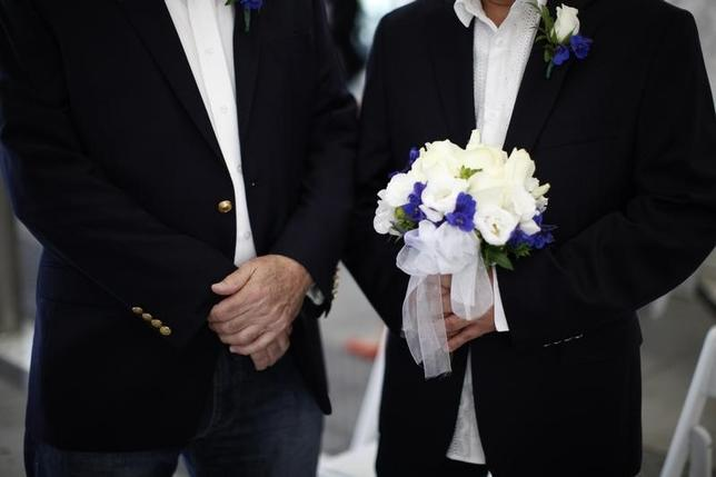 Robert O'Rourke, 65, (L) and Rick Nelson Flor, 53, prepare to get married in West Hollywood, California, July 1, 2013. REUTERS/Lucy Nicholson