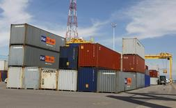 A truck is loaded with a container at the Port of Montreal, September 27, 2010.  REUTERS/Shaun Best  (CANADA - Tags: TRANSPORT) - RTXSQDV