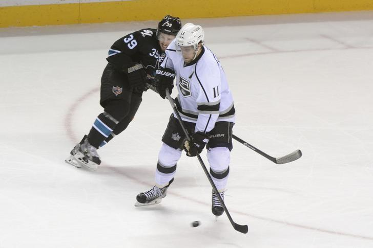 Los Angeles Kings center Anze Kopitar (11) controls the puck against San Jose Sharks center Logan Couture (39) during the third period in game seven of the first round of the 2014 Stanley Cup Playoffs at SAP Center at San Jose on April 30, 2014. USA TODAY Sports/ Kyle Terada