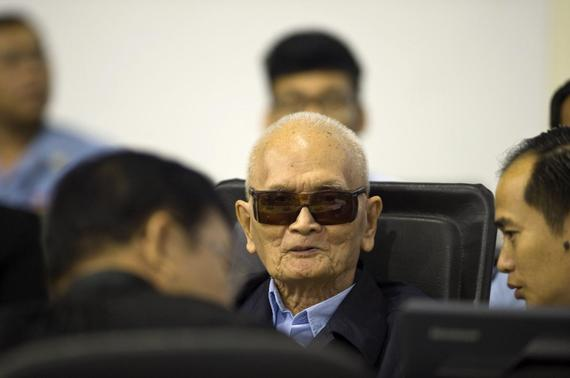 In this handout photo courtesy of the ECCC, former Khmer Rouge leader ''Brother Number Two'' Nuon Chea (C) sits at the Extraordinary Chambers in the Courts of Cambodia (ECCC) as his verdict is delivered on the outskirts of Phnom Penh August 7, 2014. REUTERS-Mark Peters-ECCC-Handout via Reuters