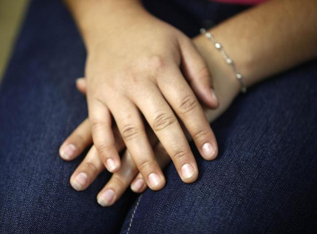 Maria, 18, who is an undocumented migrant from Central America, is seen in Los Angeles, California, July 22, 2014. REUTERS/Lucy Nicholson