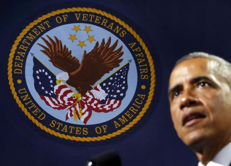 The emblem for the U.S. Department of Veteran's Affairs is seen as U.S. President Barack Obama speaks at Ft. Belvoir, Virginia, August 7, 2014. REUTERS/Larry Downing