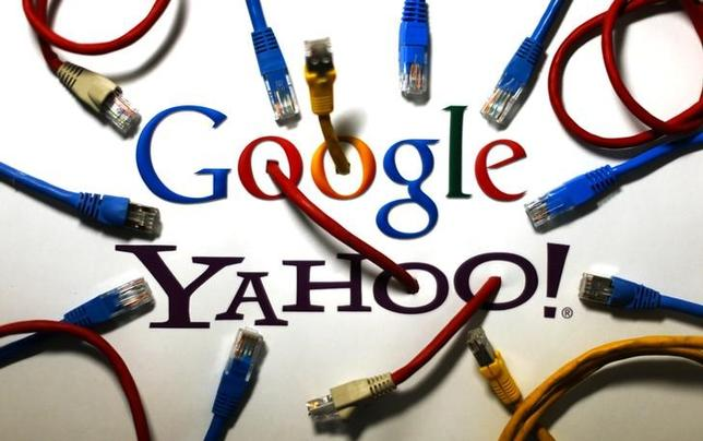 An illustration picture shows the logos of Google and Yahoo connected with LAN cables in a Berlin office October 31, 2013.  REUTERS/Pawel Kopczynski/Files