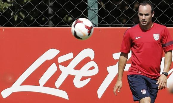 U.S. national soccer team player Landon Donovan looks at the ball during a training session in Sao Paulo January 23, 2014. REUTERS/Nacho Doce/Files