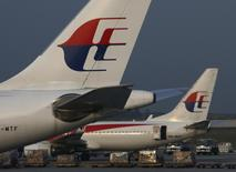 Malaysia Airlines planes sit on the tarmac at Kuala Lumpur International Airport July 21, 2014.  REUTERS/Edgar Su