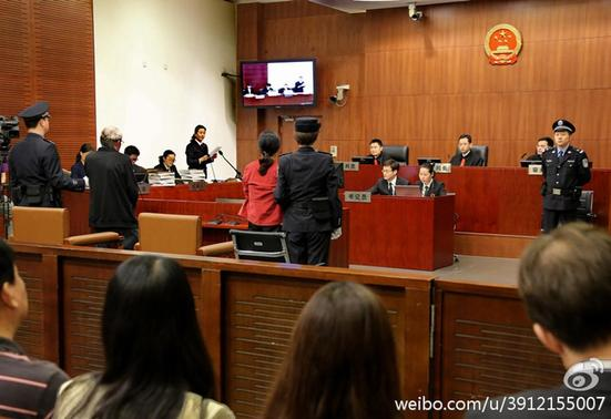 Peter Humphrey (center L) and Yu Yingzeng (center R) stand trial at Shanghai No.1 Intermediate People's Court, August 8, 2014.  REUTERS- Shanghai No.1 Intermediate People's Court-Handout via Reuters