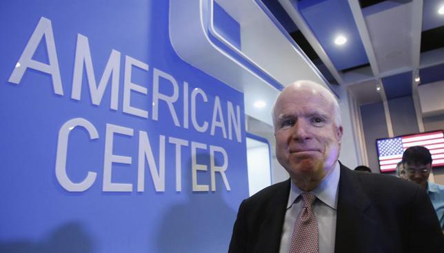 U.S. Senator for Arizona John McCain leaves the American Center after a press briefing in Hanoi August 8, 2014. REUTERS/Kham