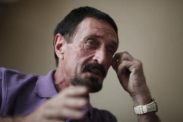 John McAfee, anti-virus software guru, speaks during an interview with Reuters in Guatemala City December 5, 2012. REUTERS/Jorge Dan Lopez/Files