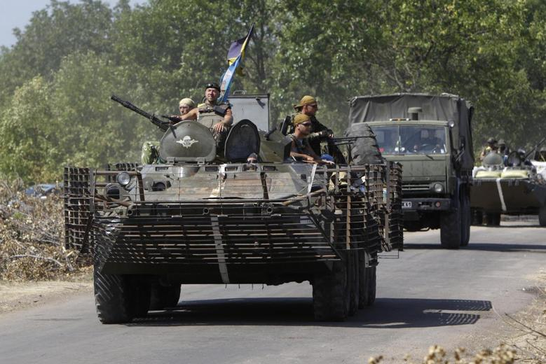 A Ukrainian military convoy moves along a road near Donetsk August 9, 2014.  REUTERS/Valentyn Ogirenko