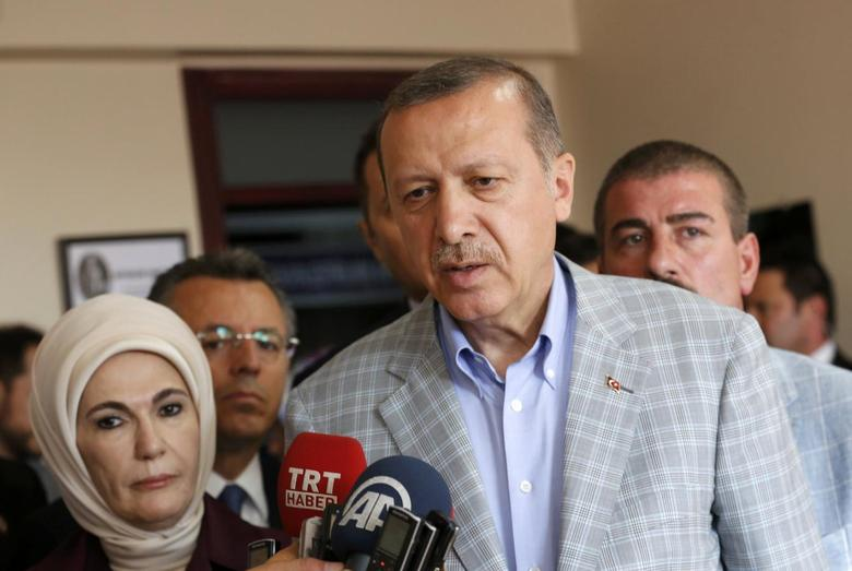 Prime Minister and presidential candidate Tayyip Erdogan talks with media during presidential elections in Istanbul August 10, 2014.  REUTERS/Murad Sezer