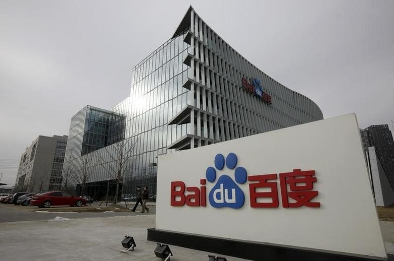 People walk in front of the headquarters of Baidu in Beijing February 10, 2010. REUTERS/Jason Lee