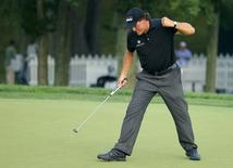 Phil Mickelson of the U.S. reacts to saving par with a long putt on the 12th hole during the final round of the 2014 PGA Championship at Valhalla Golf Club in Louisville, Kentucky, August 10, 2014. REUTERS/Brian Snyder