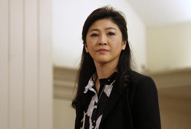 Former Thai Prime Minister Yingluck Shinawatra arrives at a hotel for a news conference in Bangkok July 18, 2014. REUTERS/Chaiwat Subprasom/Files