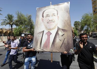 Power struggle on Baghdad streets as Maliki replaced...