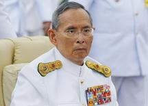 Thailand's King Bhumibol Adulyadej arrives to preside over the unveiling ceremony for the King Rama VIII monument in Bangkok June 9, 2012. REUTERS/Damir Sagolj